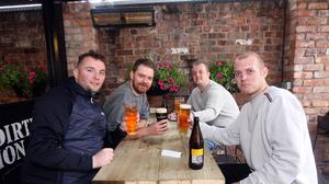 Antonio Getty, John Macrory, and brothers Gary and William Blackadder enjoying their first pints from lockdown. NI hotels and bars reopen their doors. Pic Freddie Parkinson.
