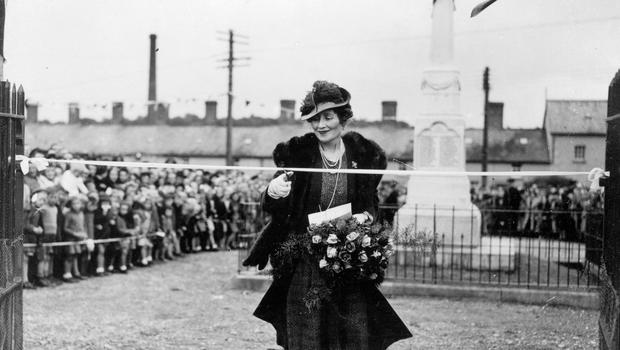 The Countess Granville, wife of the Ulster Governor and sister of Queen Elizabeth, the Queen Mother, cutting ribbon to open childrens play centre at Bessbrook.  15/9/1945