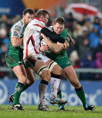 Ulster's Roger Wilson tackled Tom McCartney of Connacht. INPHO/James Crombie.