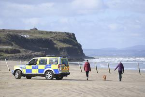 A PSNI patrol car sits on Castlerock Beach to deter groups of people gathering who should be self isolating during the coronavirus outbreak. Picture: Michael Cooper