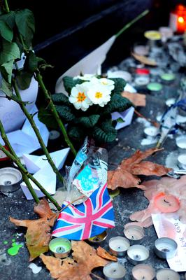 Floral tributes and candles left at Place de la Republique in Paris following the terrorist attacks on Friday evening. PRESS ASSOCIATION Photo. Picture date: Monday November 16, 2015. See PA story POLICE Paris. Photo credit should read: Steve Parsons/PA Wire