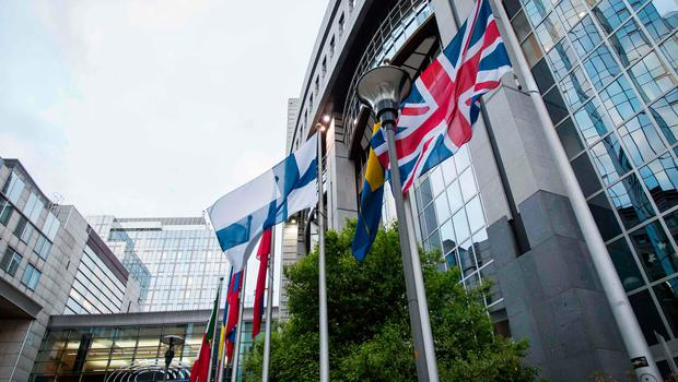 A picture taken on March 29, 2017 shows British flags at the UK representation to the European Union in Brussels.  Britain's ambassador to the EU Tim Barrow will deliver to Brussels today the letter signed by British Prime Minister Theresa May that will launch Brexit. / AFP PHOTO / Aurore BelotAURORE BELOT/AFP/Getty Images