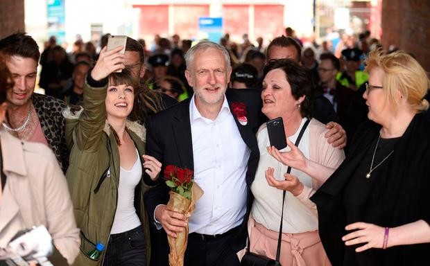 Britain's main opposition Labour Party leader Jeremy Corbyn leaves after addressing supporters at a campaign visit in Colwyn Bay, north Wales on June 7, 2017, on the eve of the general election. Britain on Wednesday headed into the final day of campaigning for a general election darkened and dominated by jihadist attacks in two cities, leaving forecasters struggling to predict an outcome on polling day. / AFP PHOTO / Oli SCARFFOLI SCARFF/AFP/Getty Images
