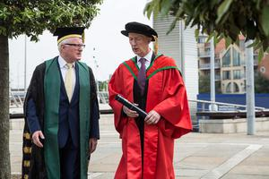 Michael Ryan, vice-president and general manager of Bombardier Aerospace, received the honorary degree of Doctor of Science (DSc) for distinguished services to business and corporate social responsibility. He is pictured here with Professor Alastair Adair. (Photo: Nigel McDowell/Ulster University)
