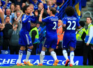 Chelsea's Loic Remy (left) celebrates scoring his side's second goal with teammates Branislav Ivanovic (centre) and Willian during the Barclays Premier League match at Stamford Bridge, London. Nick Potts/PA Wire.