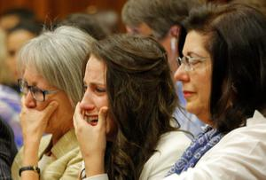 Sister of Oscar Pistorius, Aimee Pistorius, second from right, cries as she listens as her brother testifies in court in Pretoria, South Africa, Tuesday, April 8, 2014. Pistorius is charged with the murder of his girlfriend Reeva Steenkamp, on Valentines Day 2013. (AP Photo/Kim Ludbrook, Pool)