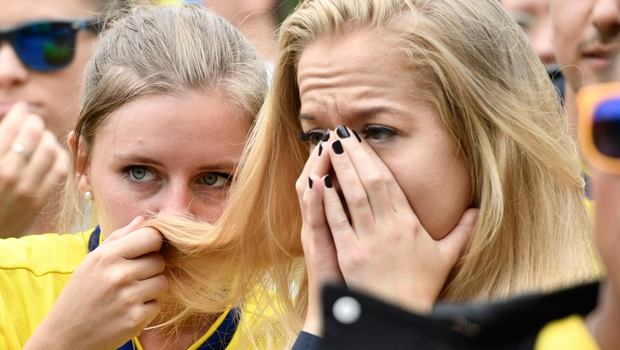 Swedish fans react as they watch the round of 16 World Cup 2018 football match between Sweden and Switzerland during a public viewing at Norra Bantorget in Stockholm, Sweden on July 3, 2018.  / AFP PHOTO / TT News Agency / Erik SIMANDER / Sweden OUTERIK SIMANDER/AFP/Getty Images