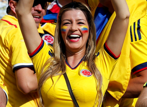 A Colombian supporter celebrates after Teofilo Gutierrez scored his side's second goal during the group C World Cup soccer match between Colombia and Greece at the Mineirao Stadium in Belo Horizonte, Brazil, Saturday, June 14, 2014.   (AP Photo/Jon Super)
