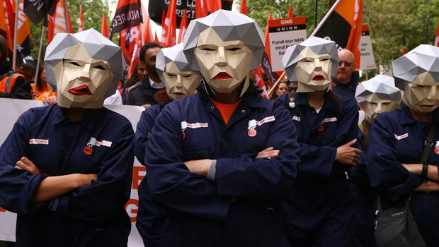 People dressed as Theresa May Bots during the TUC rally (Gareth Fuller/PA)