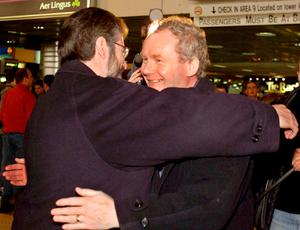 File photo dated 15/03/2000 of Sinn Fein President Gerry Adams (left) and Martin McGuinness embracing at Dublin Airport. Chris Bacon/PA Wire