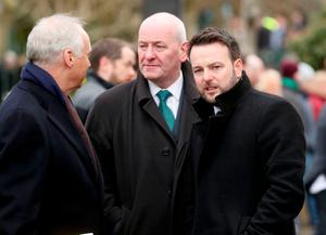 (From the left) Ireland Funds John Fitzpatrick, SDLP MP Mark Durkan and SDLP leader Colum Eastwood arriving for the funeral of Northern Ireland's former deputy first minister and ex-IRA commander Martin McGuinness, at St Columba's Church Long Tower, in Londonderry. Niall Carson/PA Wire