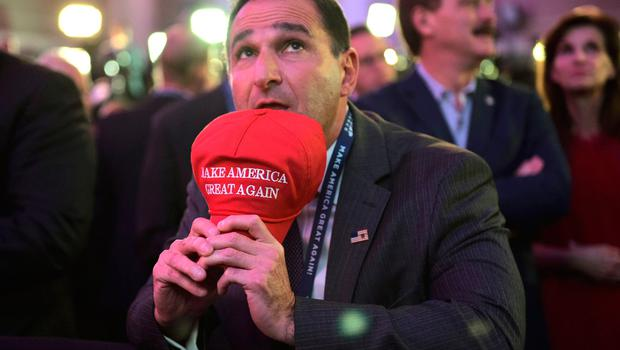 A Republican presidential nominee Donald Trump's supporter watches result unfold on a screen during election night at the New York Hilton Midtown in New York on November 8, 2016.  / AFP PHOTO / Mandel NGANMANDEL NGAN/AFP/Getty Images