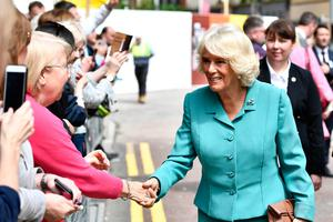 BELFAST, NORTHERN IRELAND - MAY 22: Camilla, Duchess Of Cornwall during a visit to Belfast on May 22, 2019 in Belfast, Northern Ireland. The Prince of Wales and Duchess Of Cornwall attended a walkabout and visited the Primark store following the blaze which destroyed the iconic building last August. (Photo by Charles McQuillan/Getty Images)