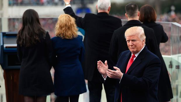 US President-elect Donald Trump applauds after Vice President Mike Pence (C rear) was sworn in during the Presidential Inauguration at the US Capitol in Washington, DC, on January 20, 2017. / AFP PHOTO / POOL / SAUL LOEBSAUL LOEB/AFP/Getty Images