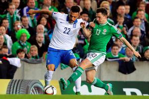 Northern Ireland's Corry Evans (R) vie for the ball with Greece's Andreas Samaris during the UEFA Euro 2016 qualifying Group F football match between Northern Ireland and Greece at Windsor Park in Belfast, Northern Ireland, on October 8, 2015.    AFP PHOTO / PAUL FAITHPAUL FAITH/AFP/Getty Images
