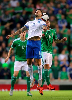 Greece's Panagiotis Kone and Northern Ireland's Oliver Norwood (right) battle for the ball the UEFA European Championship Qualifying match at Windsor Park, Belfast. PRESS ASSOCIATION Photo. Picture date: Thursday October 8, 2015. See PA story SOCCER N Ireland. Photo credit should read: Niall Carson/PA Wire.