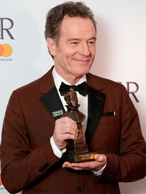 Bryan Cranston, winner of the Best Actor award for 'Network', poses in the press room during The Olivier Awards (Photo by John Phillips/John Phillips/Getty Images)