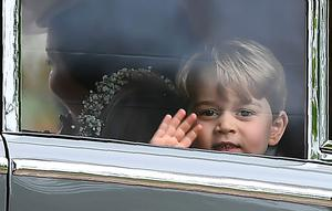 Britain's Prince George waves as he leaves in a car after attending the wedding of his aunt, Pippa Middleton, to James Matthews at St Mark's Church in Englefield, west of London, on May 20, 2017. After turning heads at her sister Kate's wedding to Prince William, Pippa Middleton graduated from bridesmaid to bride on Saturday at a star-studded wedding in an English country church. The 33-year-old married financier James Matthews, 41, at a ceremony attended by the royal couple and tennis star Roger Federer, wearing a couture dress by British designer Giles Deacon.  / AFP PHOTO / POOL / Justin TALLISJUSTIN TALLIS/AFP/Getty Images