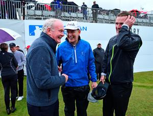 NEWCASTLE, NORTHERN IRELAND - MAY 27 : Deputy First Minister Martin McGuinness (L), talks with TV personality Patrick Kielty and Former Jockey AP McCoy on the 18th green after playing in the Pro-Am during the Irish Open Previews at Royal County Down Golf Club on May 27, 2015 in Newcastle, United Kingdom. (Photo by Mark Runnacles/Getty Images)