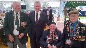 First Minister Peter Robinson has attended the 70th D-Day commemorations in Normandy.  He is pictured following a service at Bayeux Cemetry with George Thompson (Royal Navy), Neville Henshaw (Royal Signals) and John Leishman (51st Highland Division). Press Eye