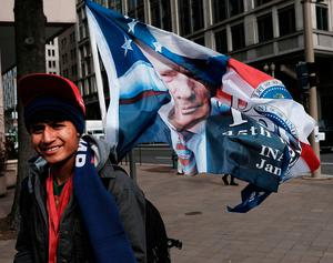 WASHINGTON, DC - JANUARY 19:  A vendor sells Donald Trump merchandise near the National Mall on January 19, 2017 in Washington, DC. Washington and the entire nation are preparing for the transfer of the United States presidency as Trump is sworn is as the 45th president on January 20.  (Photo by Spencer Platt/Getty Images)