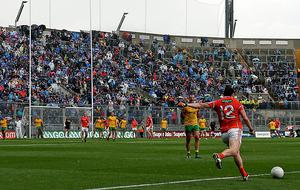 Missed opportunities:Tony Kernan fails to score with the second of two crucial kicks for Armagh in the 2014 All-Ireland quarter-final against Donegal
