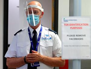 Security Staff member wears PPE at Belfast International Airport which reopens on Monday June 15th. PA Photo. Picture date: Thursday June 11, 2020. See PA story HEATH Coronavirus Ulster . Photo credit should read: Niall Carson/PA Wire