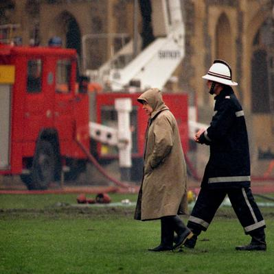 File photo dated 21/11/92 of Queen Elizabeth II surveying the scene at following the fire at Windsor Castle as she turns 90 on the April 21st. PRESS ASSOCIATION Photo. Issue date: Sunday April 3, 2016. See PA story ROYAL Birthday. Photo credit should read: Sean Dempsey/PA Wire