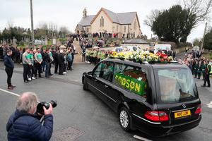 The hearse arrives at the funeral of Connor Currie at St Malachy's Church, Edendork. PRESS ASSOCIATION Photo. Picture date: Friday March 22, 2019. Teenagers  Lauren Bullock, Connor Currie and Morgan Barnard died after a crush at the Greenvale Hotel in Cookstown, Co Tyrone, on Sunday. See PA story ULSTER Cookstown. Photo credit should read: Brian Lawless/PA Wire