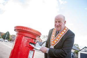 Grand Master of the Grand Orange Lodge of Ireland, Edward Stevenson, posting one of the light-hearted Christmas cards made available by the Institution this year