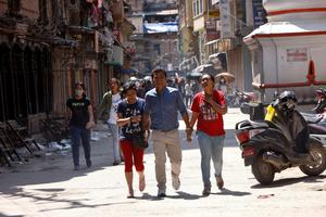 Nepalese people rush to safer areas as an earthquake hits Kathmandu, Nepal, Tuesday, May 12, 2015. A major earthquake hit Nepal in a remote region near the Chinese border on Tuesday, less than three weeks after the country was ravaged by another deadly quake. (AP Photo/Bikram Rai)