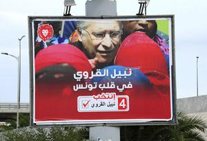 An electoral poster for Nabil Karoui (Hassene Dridi/AP)