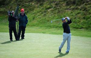 NEWCASTLE, NORTHERN IRELAND - MAY 28:  Francesco Molinari of Italy hits his 2nd shot on the 13th hole filmed by a TV Camera during the First Round of the Dubai Duty Free Irish Open Hosted by the Rory Foundation at Royal County Down Golf Club on May 28, 2015 in Newcastle, Northern Ireland.  (Photo by Ross Kinnaird/Getty Images)