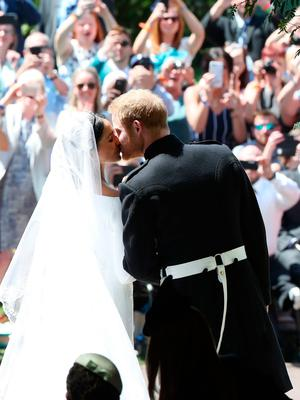 Prince Harry and Meghan Markle kiss on the steps of St George's Chapel in Windsor Castle after their wedding. PRESS ASSOCIATION Photo. Picture date: Saturday May 19, 2018. See PA story ROYAL Wedding. Photo credit should read: Danny Lawson/PA Wire