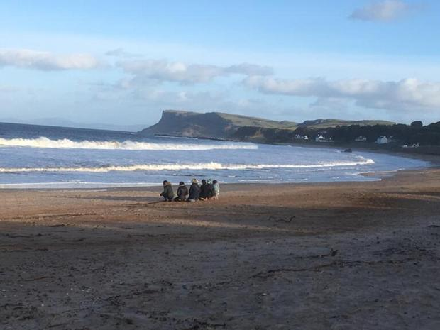 Friends and family of Deidre McShane together on Ballycastle beach.