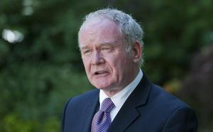 """Martin McGuinness will not be """"silenced or deterred"""" by death threat."""