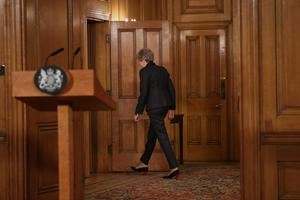 Theresa May leaves after making her statement (Jonathan Brady/PA)