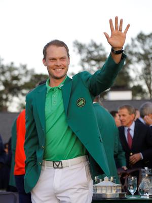 Master champion Danny Willett, of England, waves after winning the Masters golf tournament Sunday, April 10, 2016, in Augusta, Ga. (AP Photo/Jae C. Hong)