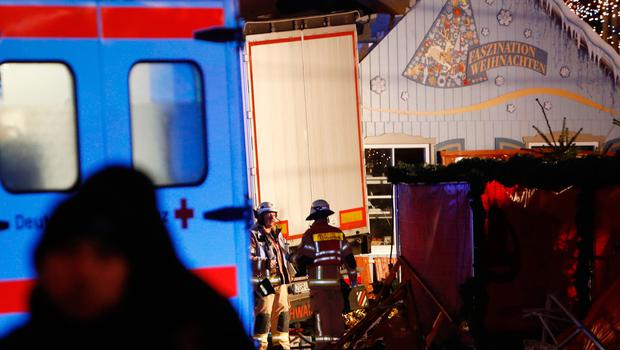 Rescue forces work at the truck that crashed into a Christmas market in Berlin, on December 19, 2016 killing nine persons and injuring at least 50 people. AFP/Getty Images