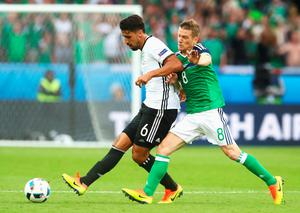 PARIS, FRANCE - JUNE 21: Sami Khedira of Germany and Steven Davis of Northern Ireland compete for the ball during the UEFA EURO 2016 Group C match between Northern Ireland and Germany at Parc des Princes on June 21, 2016 in Paris, France.  (Photo by Alexander Hassenstein/Getty Images)