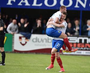 Can I have a piggy man? CARRY ME!: Linfield's Niall Quinn (31) celebrates his goal with Andrew Mitchell. Photo Charles McQuillan/Pacemaker Press