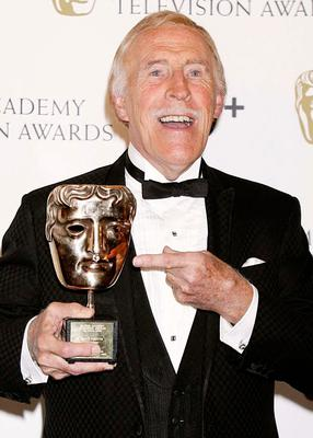 Bruce Forsyth with the Bafta Fellowship award during the British Academy Television Awards at the London Palladium in central London. Yui Mok/PA Wireholder.