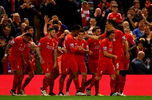 LIVERPOOL, ENGLAND - APRIL 20:  Philippe Coutinho of Liverpool celebrates with team mates after scoring his sides fourth goal during the Barclays Premier League match between Liverpool and Everton at Anfield, April 20, 2016, Liverpool, England  (Photo by Clive Brunskill/Getty Images)
