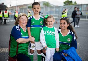 Northern Ireland fans Mildred Singh with her grandchildren Theo and Indi Thompson and mum Alexis Thompson before the international friendly match between Northern Ireland against New Zealand at Windsor Park, Belfast.  Liam McBurney/PA Wire.
