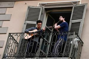 Italian musicians perform on their balcony during lockdown