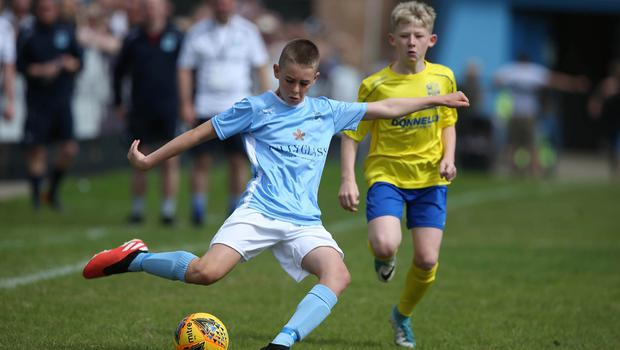PressEye-Northern Ireland- 1st August 2019-Picture by Brian Little/PressEye Dungannon United Youth Sam Anderson   and Ballymena United Robbie Spiers  in  STATSports SuperCupNI  Semi Final , at Anderson Park, Coleraine . Picture by Brian Little/PressEye