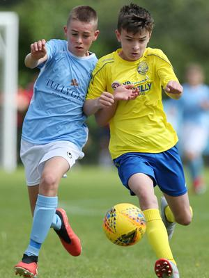 PressEye-Northern Ireland- 1st August 2019-Picture by Brian Little/PressEye Dungannon United Youth Jack McKee and    Ballymena UnitedRobbie Spiers   in  STATSports SuperCupNI  Semi Final , at Anderson Park, Coleraine . Picture by Brian Little/PressEye