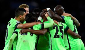 Manchester City's players celebrate after scoring a goal during the UEFA Champions League quarter final football match between Paris Saint Germain (PSG) and Manchester City on April 6, 2016 at the Parc des Princes stadium in Paris.  AFP PHOTO / FRANCK FIFEFRANCK FIFE/AFP/Getty Images