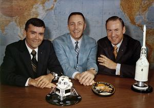 Fred Haise, Jack Swigert and Jim Lovell gather for a photo on the day before launch (Nasa/AP)