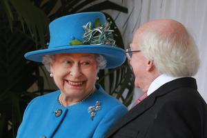 WINDSOR, ENGLAND - APRIL 08:  Queen Elizabeth II smiles as she talks with President of Ireland Michael D Higgins during a ceremonial welcome at Windsor Castle on April 8, 2014 in England. This is the first official visit by the head of state of the Irish Republic to the United Kingdom.  (Photo by Peter Macdiarmid - WPA Pool/Getty Images)